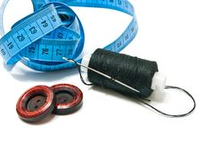 Spool of black thread, meter and two buttons Royalty Free Stock Photo
