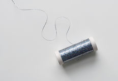 Spool of Blue Metallic Thread Stock Photos