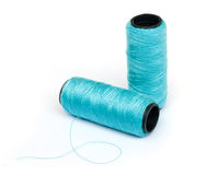Spool of blue thread. Stock Photos