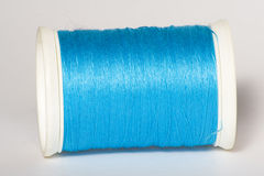 Spool of Blue Thread. Azure thread spool Stock Images