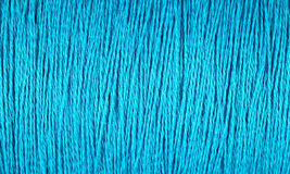 Spool of blue thread macro background Royalty Free Stock Photos