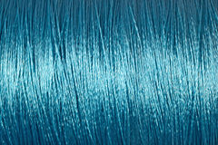 Spool of blue thread macro background Stock Photos