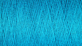 Spool of blue thread macro background Stock Photo