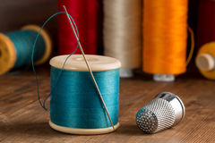 Spool of Blue Thread, a Needle, and a Thimble Stock Image