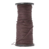 Spool of Brown Capron Thread Stock Image