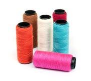 Spool of coloured  thread . Royalty Free Stock Photos