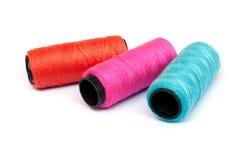 Spool of coloured  thread. Royalty Free Stock Photo