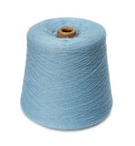 Spool of a dark blue yarn. Royalty Free Stock Photos