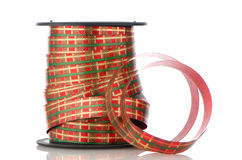 Spool with decorative red ribbon Royalty Free Stock Images