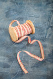 Spool of decorative ribbon Royalty Free Stock Photography