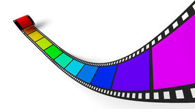 Film with rainbow colors. A spool of developed film where each  frame is a rainbow color in sequence from violet to red isolated on white background Stock Photo