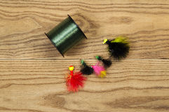 Spool of Fishing Line with Lures. Horizontal top view photo of fishing lures and spool of line on faded wood Royalty Free Stock Photography