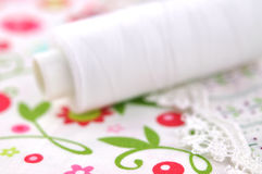 Spool on Floral Fabric Stock Images