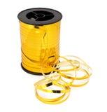 Spool golden ribbon Stock Images