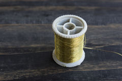 Spool of Golden Thread Stock Image