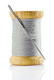 Spool with gray thread and nidle Royalty Free Stock Images