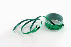 Spool of green ribbon. A spool of green ribbon on a white background stock photography