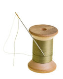 Spool of green sewing thread. A spool of green sewing thread with a needle Stock Images