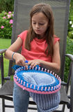 Spool  knitting. Spool or tomboy  knitting  is a form of  crochet work that uses a spool and a number of nails to produce a  tube of fabric. Spool knitting is a Stock Image