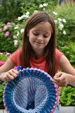 Spool  knitting. Spool or tomboy  knitting  is a form of  crochet work that uses a spool and a number of nails to produce a  tube of fabric. Spool knitting is a Royalty Free Stock Photos