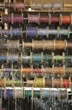 Spool of necklaces. For sale at the market Royalty Free Stock Photo