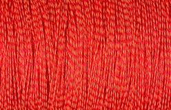 Spool of orange thread macro background Royalty Free Stock Photo