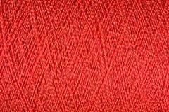 Spool of orange thread macro background Stock Images