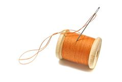 Spool of orange thread Royalty Free Stock Photo
