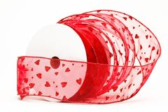 Spool of red heart ribbon Stock Image
