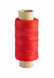 Spool with red thread isolated on white Stock Images