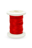 Spool of red thread. Royalty Free Stock Photo