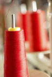 Spool of Red Thread on Machine Pin Stock Photos