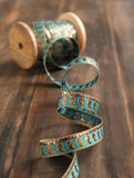 Spool of ribbon. On wooden background Royalty Free Stock Photos