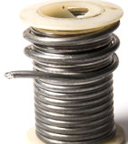 Spool of solder. Spool of tin lead solder for use in welding royalty free stock images