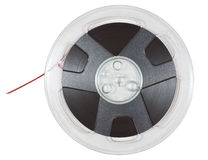 Spool of Tape. Open reel of quarter inch audio tape on spool isolated on white with clipping path Stock Images