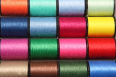 Spool of thread. Spools of colorful threads on bobbins Royalty Free Stock Photography
