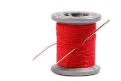 Spool of Thread. Spool of red thread on white background Royalty Free Stock Images