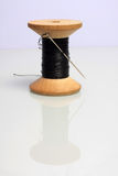 Spool of thread. Spool of black thread on white background Royalty Free Stock Photos