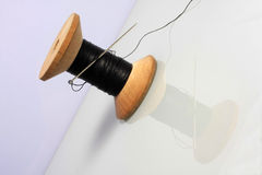 Spool of thread. Spool of black thread on white background Stock Images