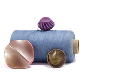 Spool of thread and buttons Royalty Free Stock Photo