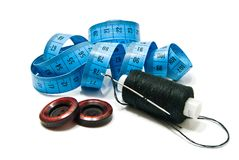 Spool of thread, buttons and meter Royalty Free Stock Image