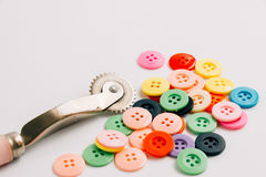 Spool of thread and buttons, sew instrument isolated on white ba Royalty Free Stock Photo