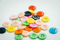 Spool of thread and buttons, sew instrument  on white ba Royalty Free Stock Images