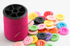 Spool of thread and buttons, sew instrument  on white ba Stock Photos