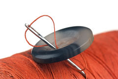 Spool of thread and buttons Stock Images
