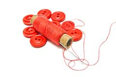 Spool of thread and buttons on white Stock Photos