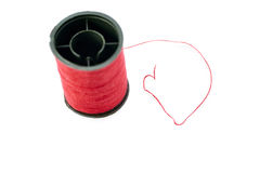 Spool of thread isolated over the white background Stock Photo