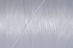 Spool of thread macro background Stock Photos