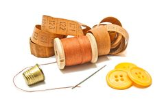 Spool of thread, meter and buttons Stock Images