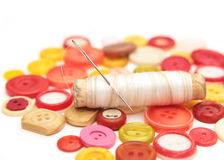 Spool of thread with a needle Royalty Free Stock Images